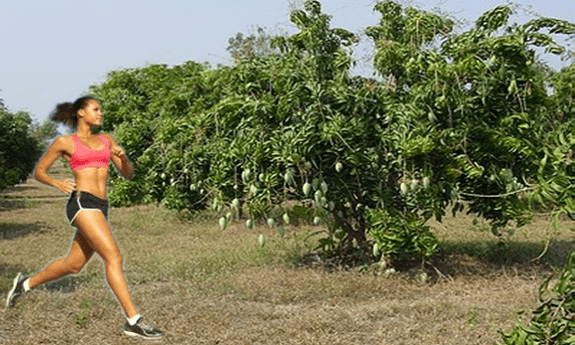Woman-running-in-African-Mango-Garden